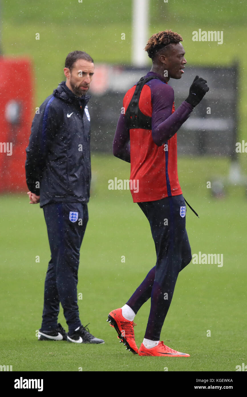 England's Tammy Abraham (right) is watched over by Gareth Southgate during the training session at St George's Park, Stock Photo