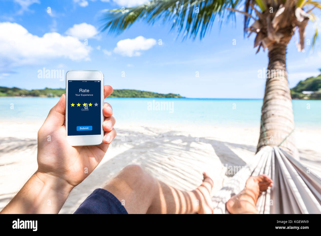 Customer review online app on smartphone screen asking user on the beach to rate experience and give feedback, satisfaction - Stock Image