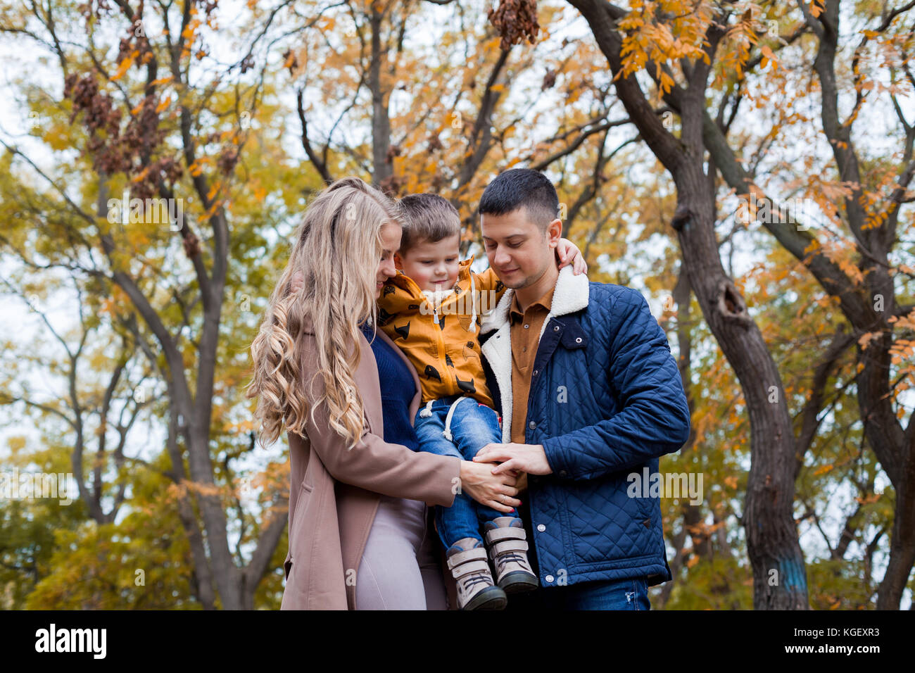 Happy family walks through the Park Winter forest - Stock Image