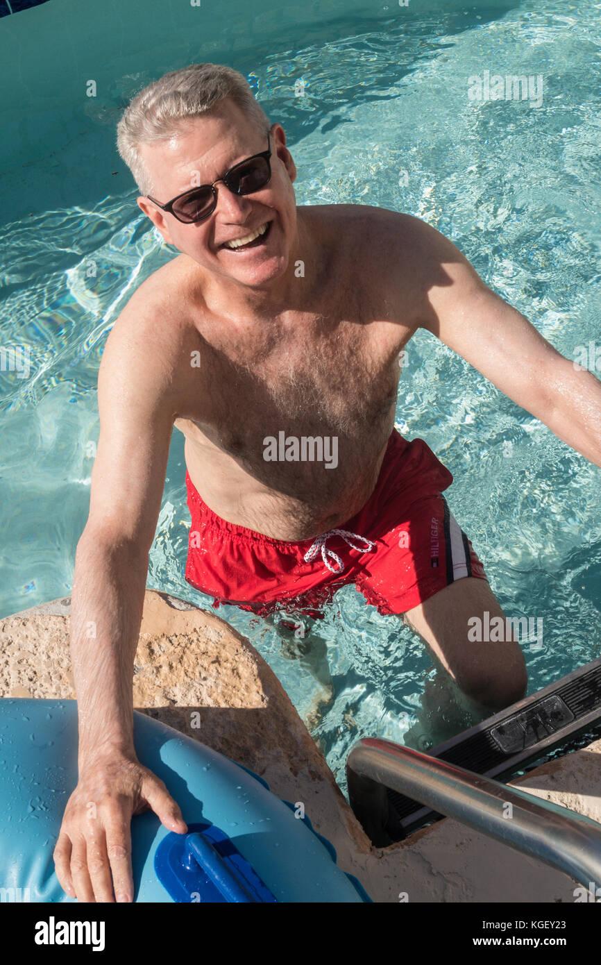 Senior Man Enjoying Resort Swimming Pool, USA - Stock Image