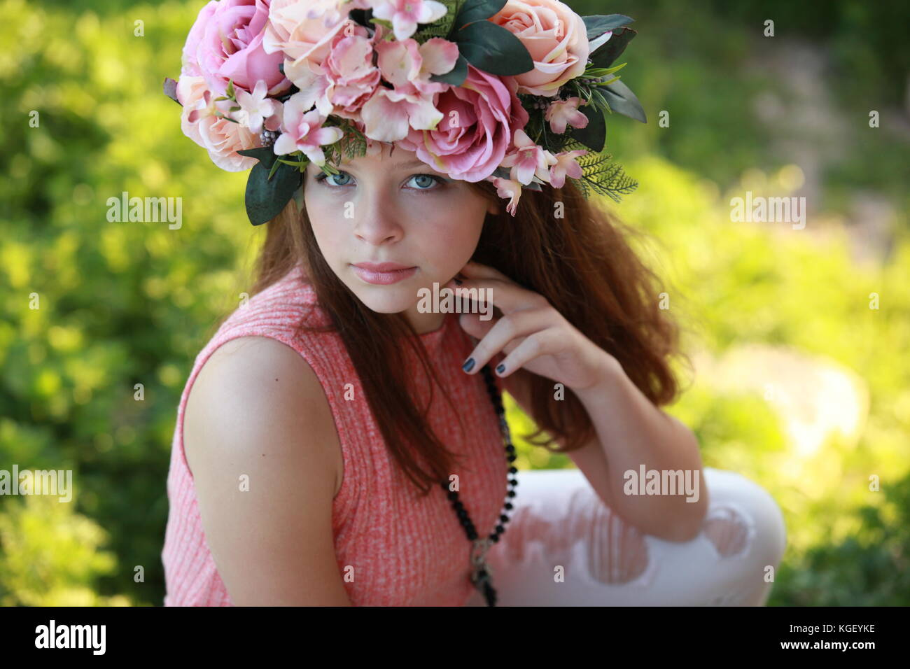 A Beautiful Young Woman Wearing A Colorful Flower Crown And Stock