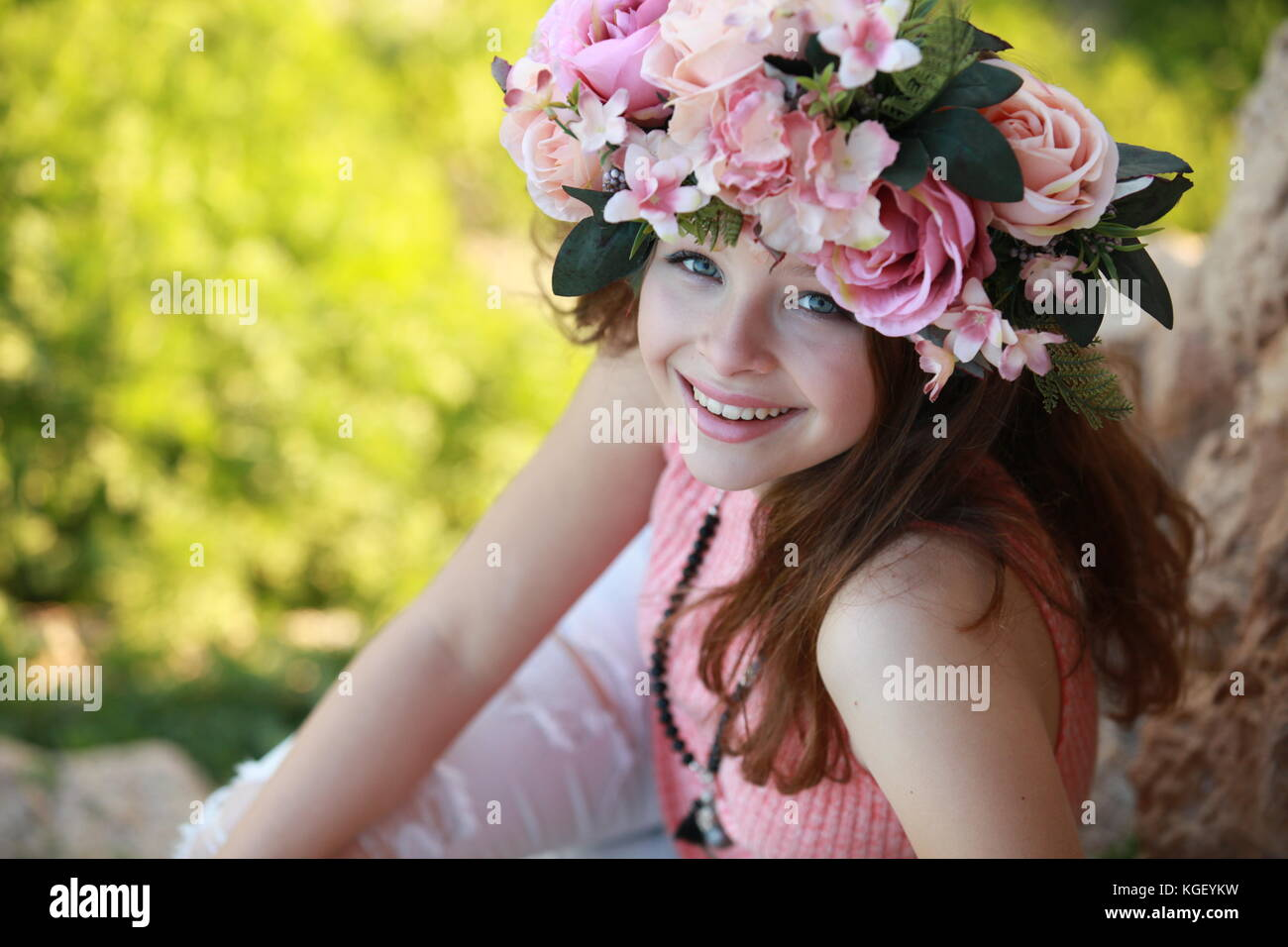 Woman wearing flowers crown stock photos woman wearing flowers a beautiful young woman wearing a colorful flower crown and fashionable clothing in a fashion shoot izmirmasajfo