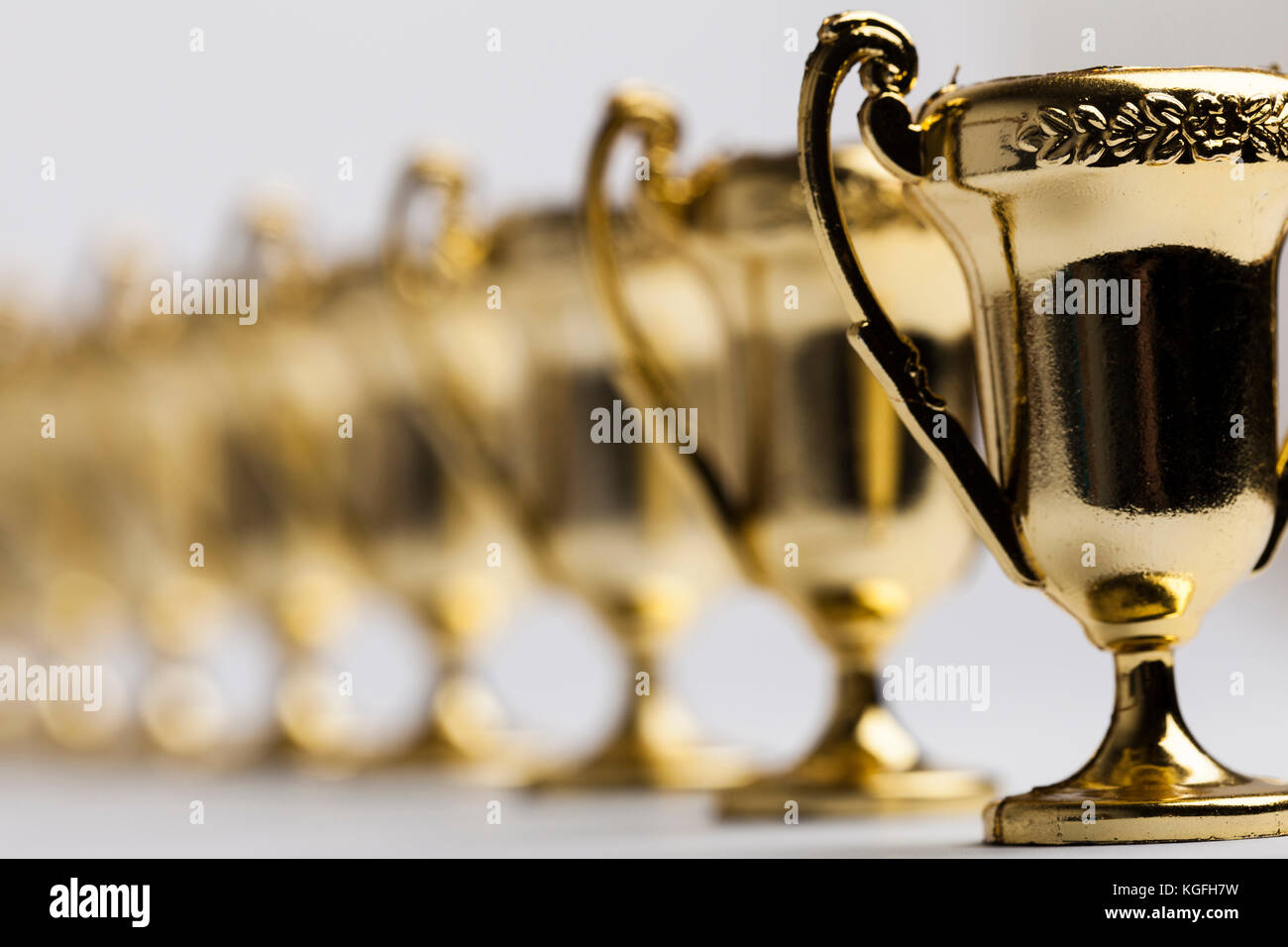 Gold winners achievement trophy background - Stock Image