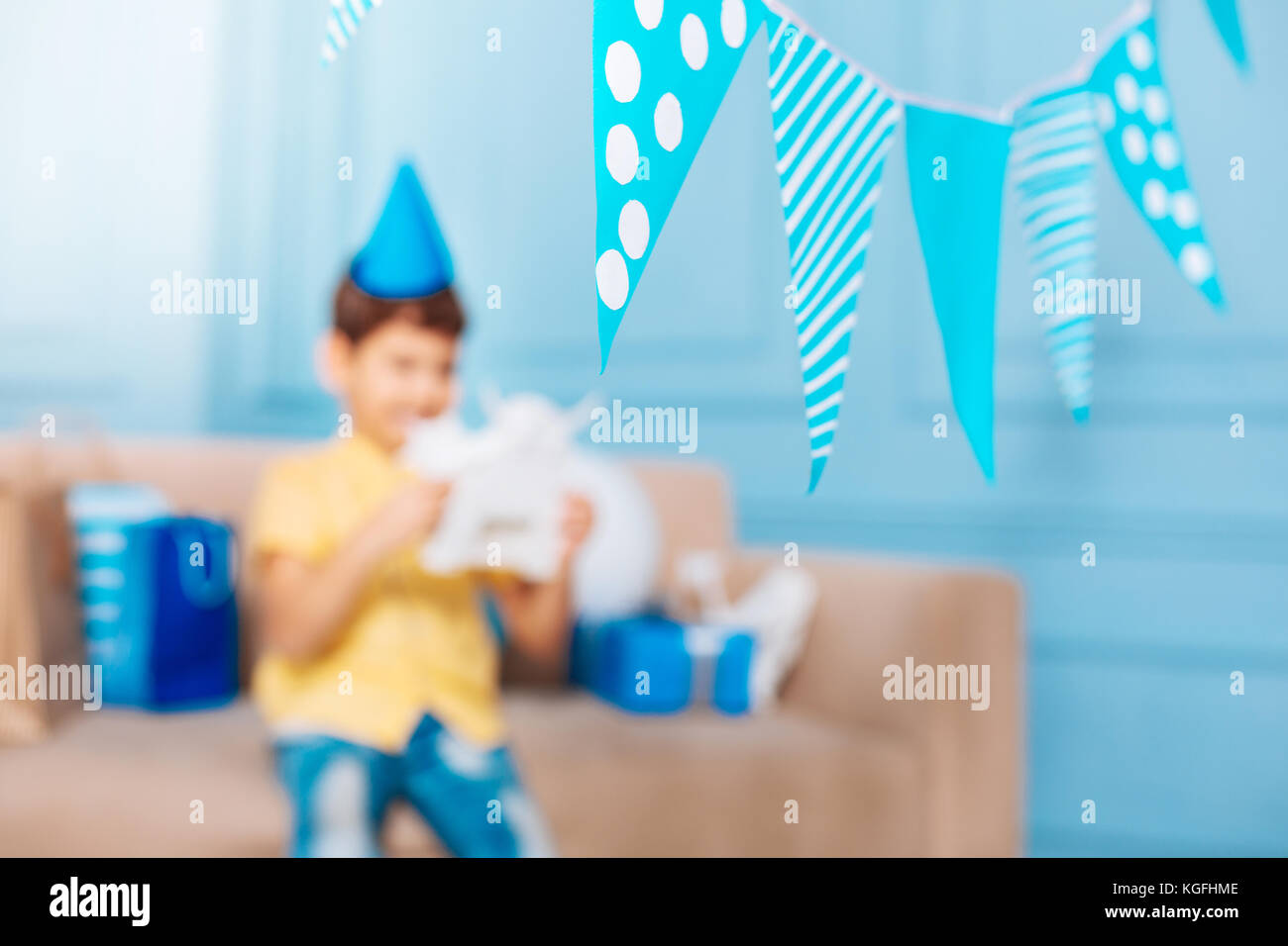 Flags hanging in the room decorated for birthday party - Stock Image