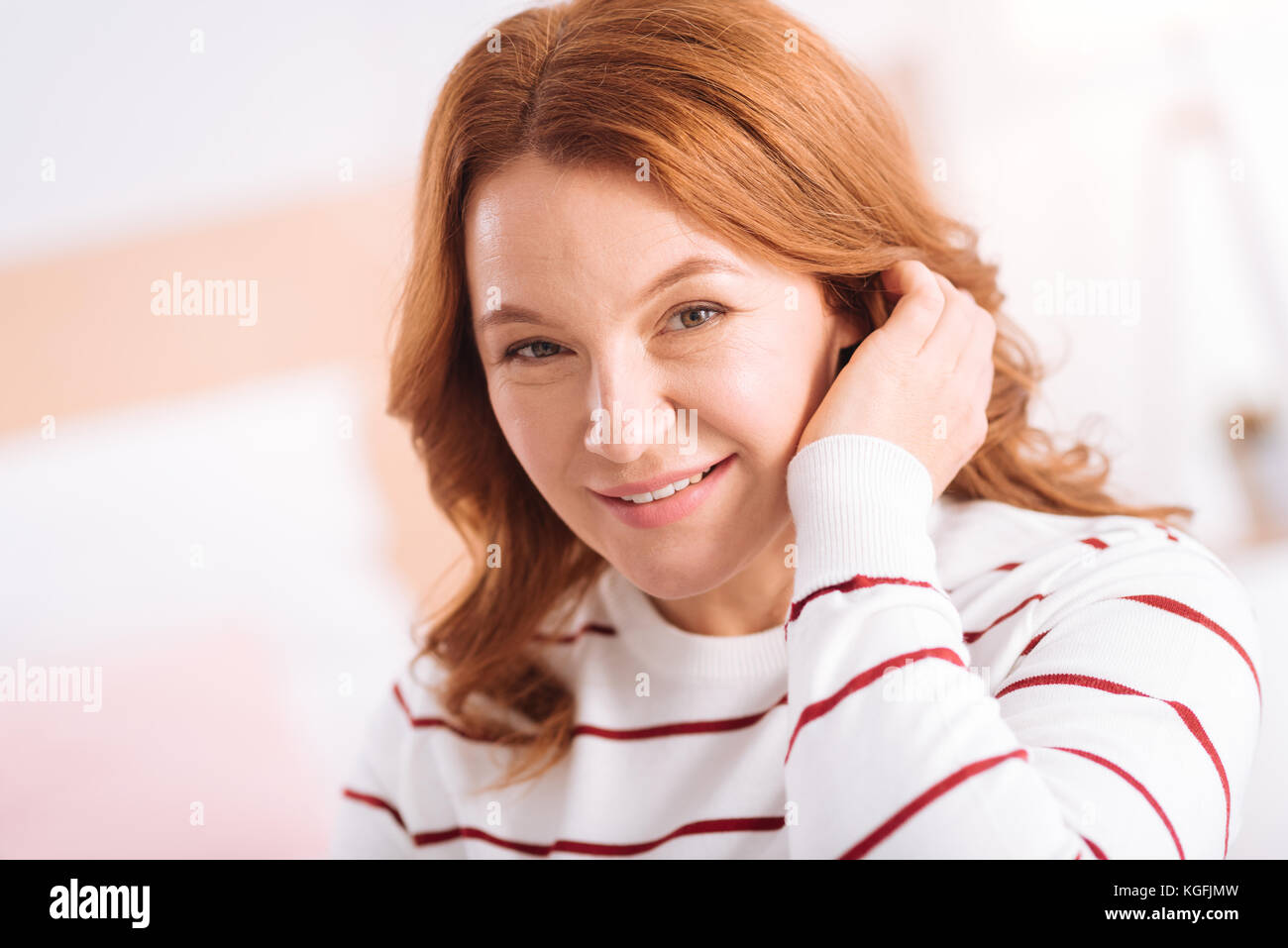 Nice content woman of middle age smiling - Stock Image