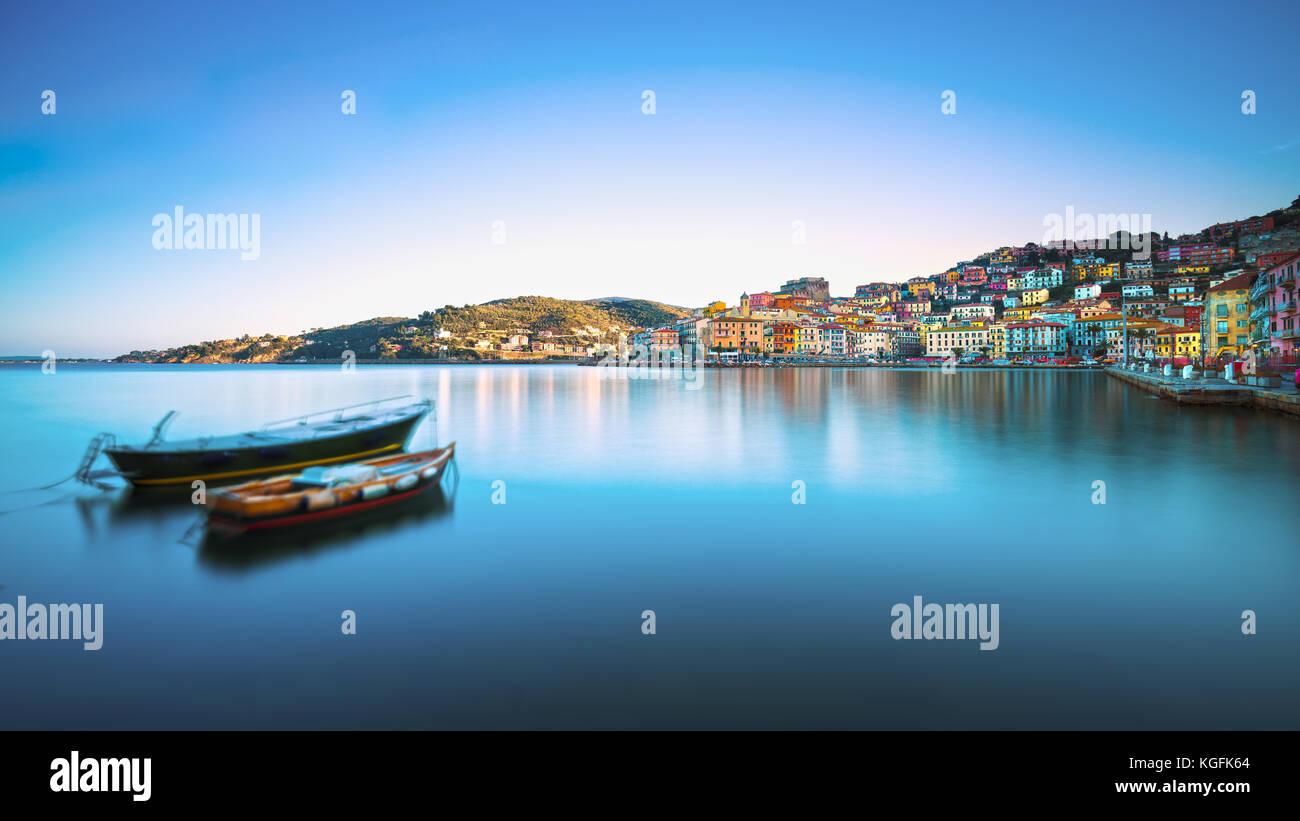 Wooden small old boats in Porto Santo Stefano seafront, italian travel destination. Monte Argentario, Tuscany, Italy. - Stock Image