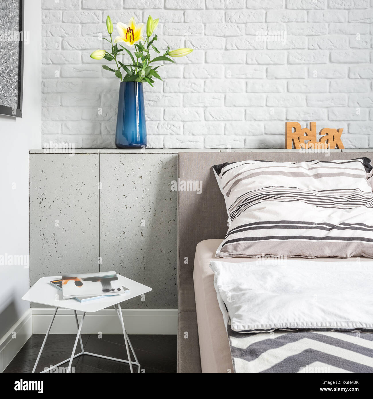 Simple Bedroom With White Brick Wall, Bed And Side Table