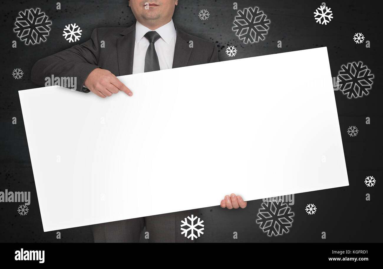 Snowflakes concept poster is held by businessman. - Stock Image