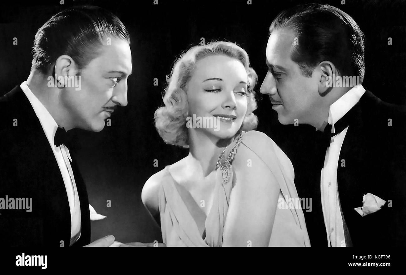 ARSENE LUPIN RETURNS 1938 MGM film with from left: Melvyn Douglas, Virginia Bruce, Warren William Stock Photo