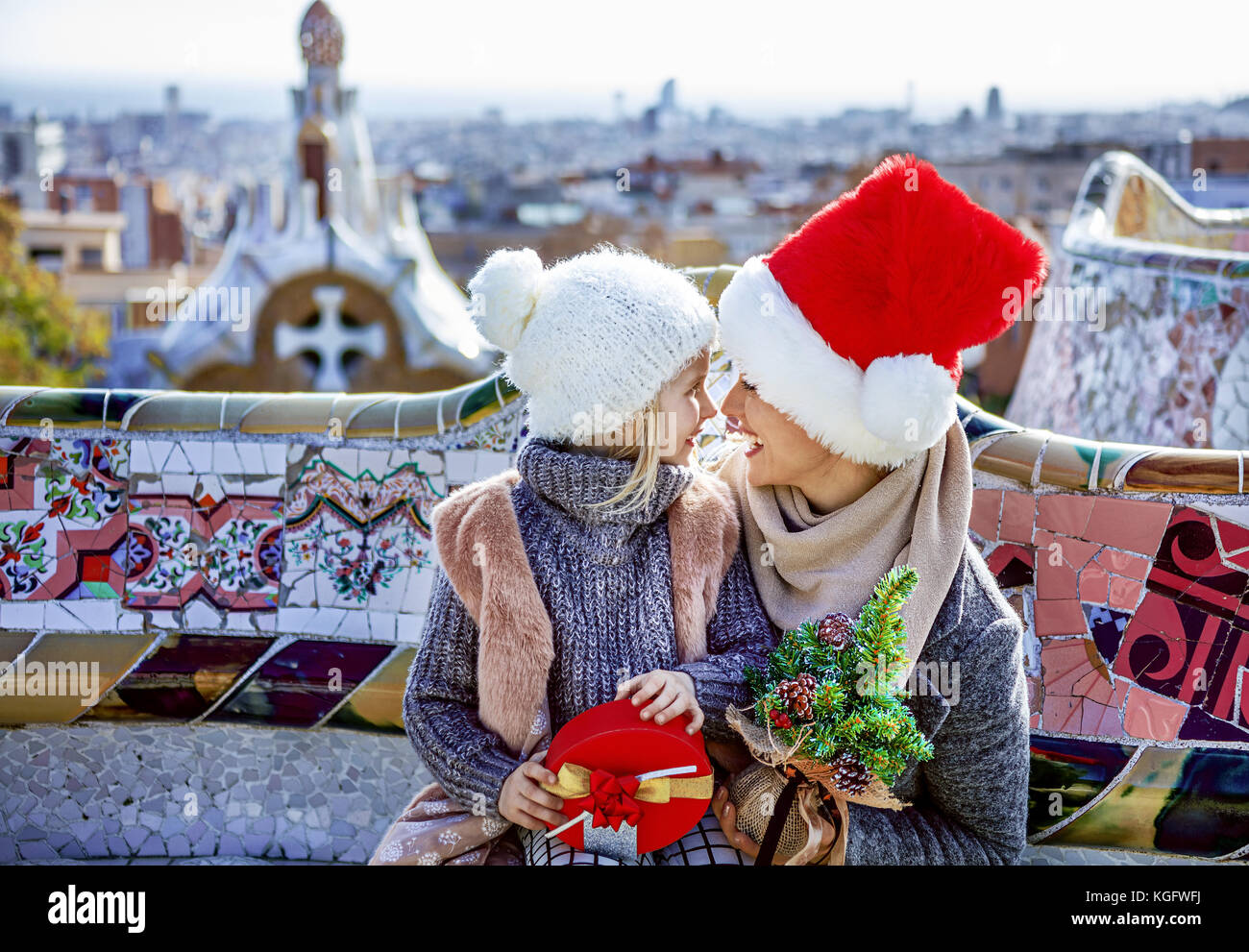 Winter wonderland in Barcelona at Christmas. Portrait of smiling trendy mother and daughter tourists with a little - Stock Image