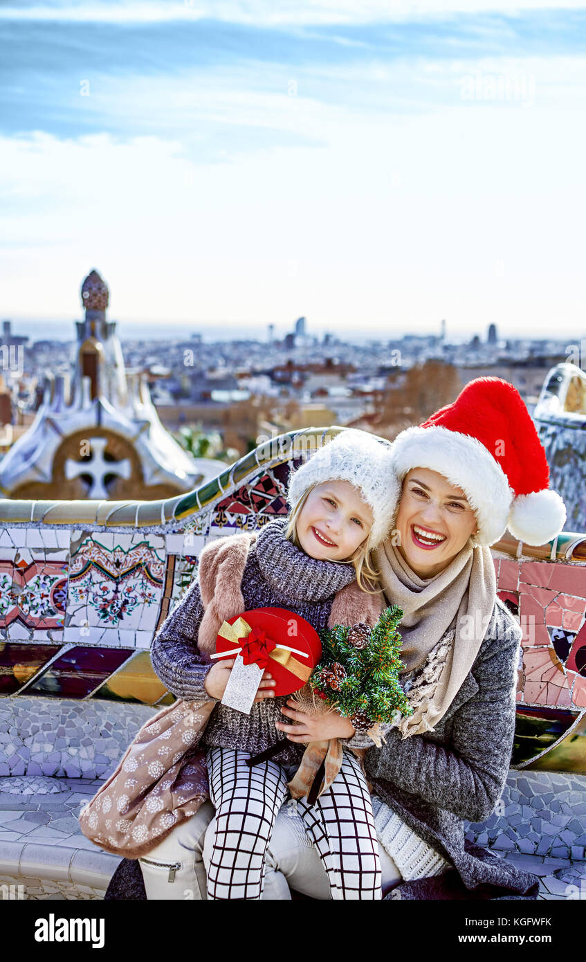 Winter wonderland in Barcelona at Christmas. Portrait of happy trendy mother and child travellers with a little - Stock Image