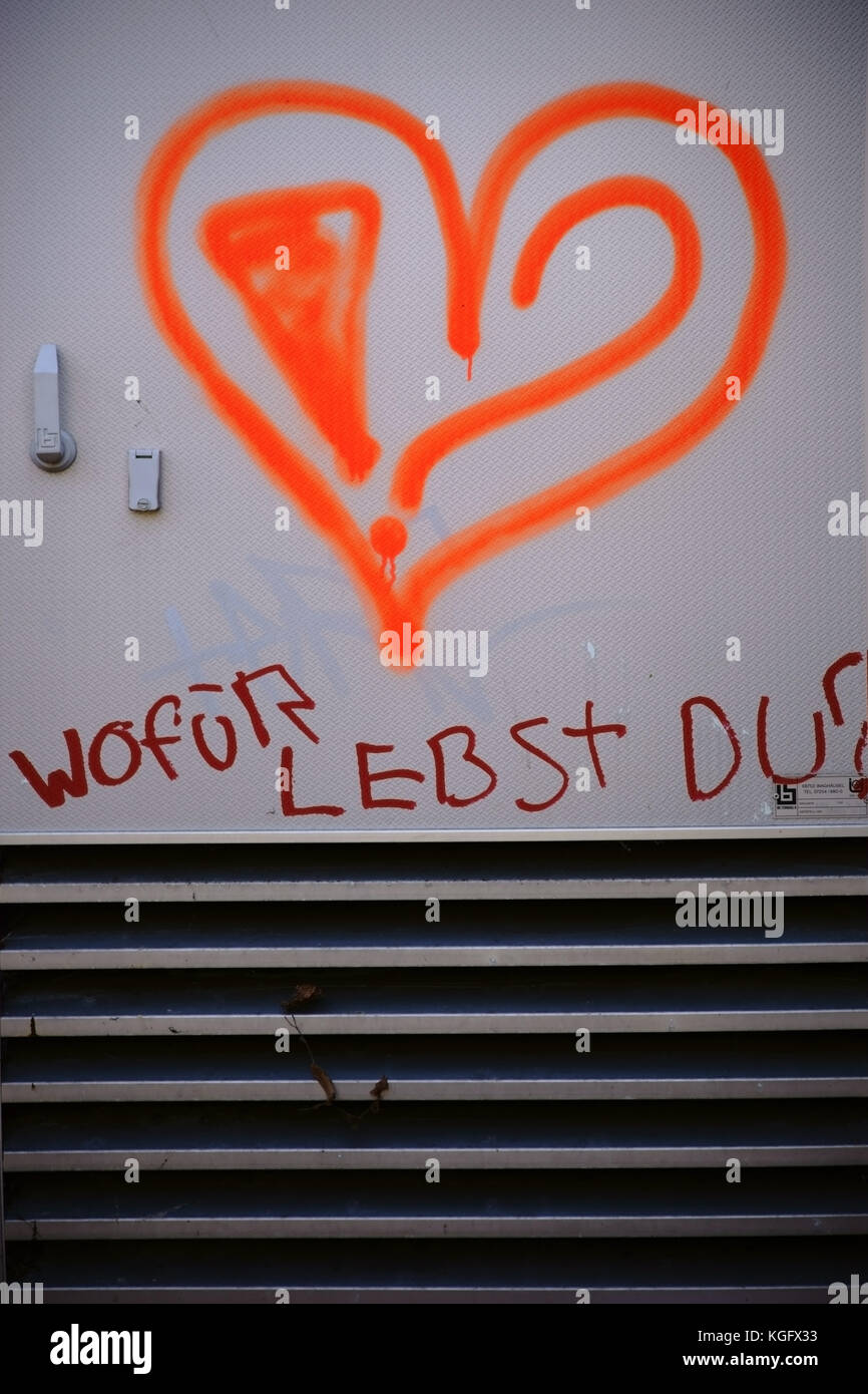 The graffiti of a heart underlined with the slogan or