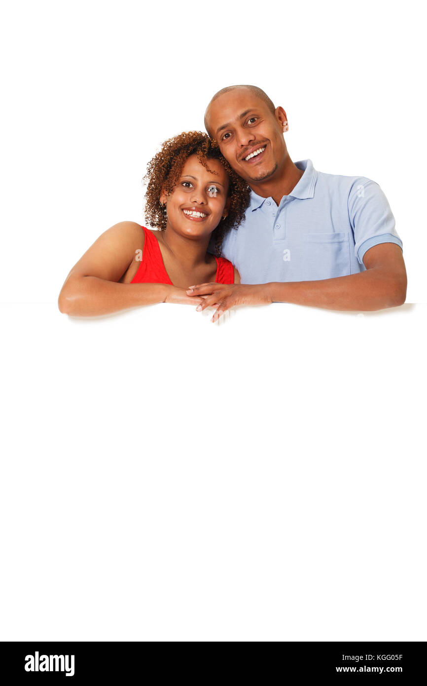 Young African-American couple with a poster. - Stock Image