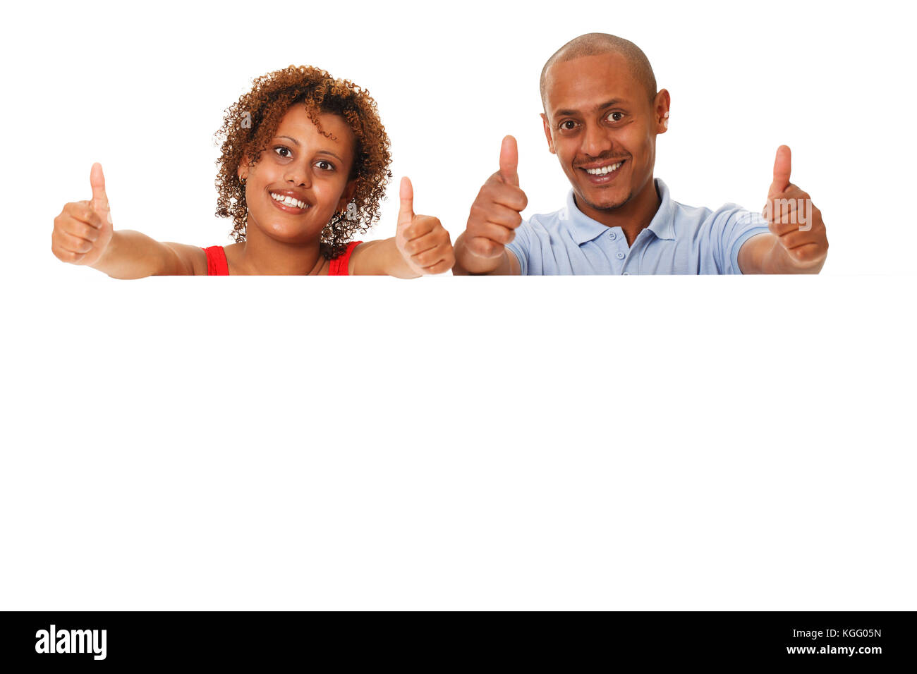 African American couple showing thumbs up with white poster. - Stock Image
