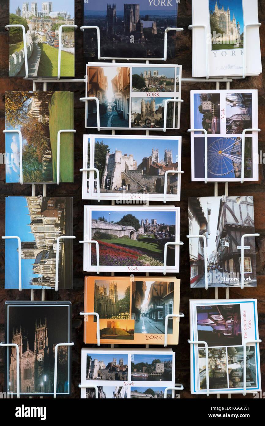UK, York, tourist postcards for sale. - Stock Image