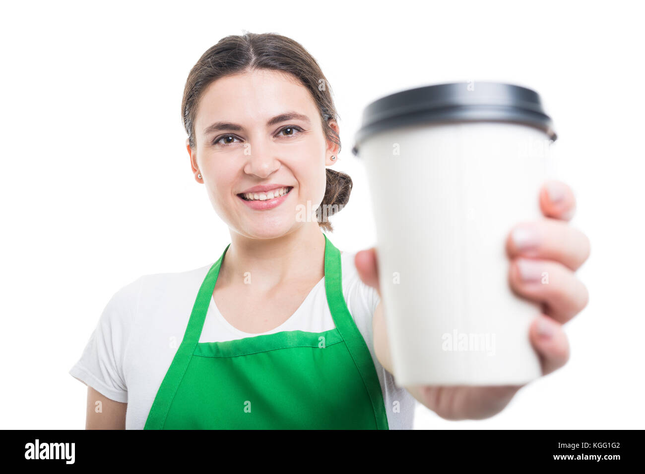 Friendly saleswoman giving you fresh coffee in closeup and smiling - Stock Image