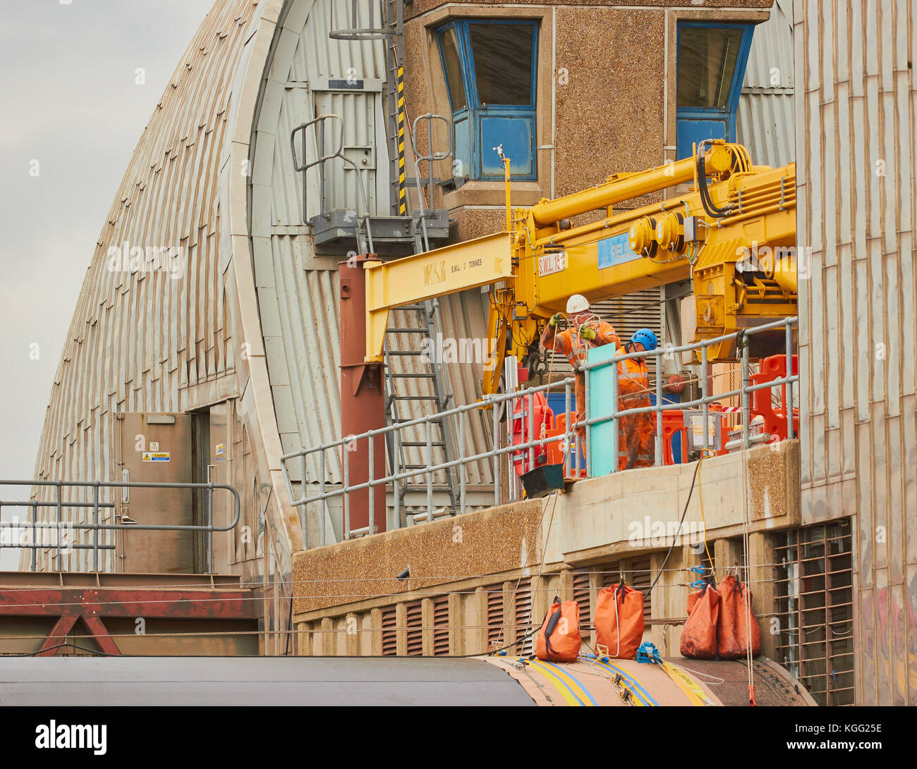 Workmen on the Thames Barrier, Greenwich, London - Stock Image