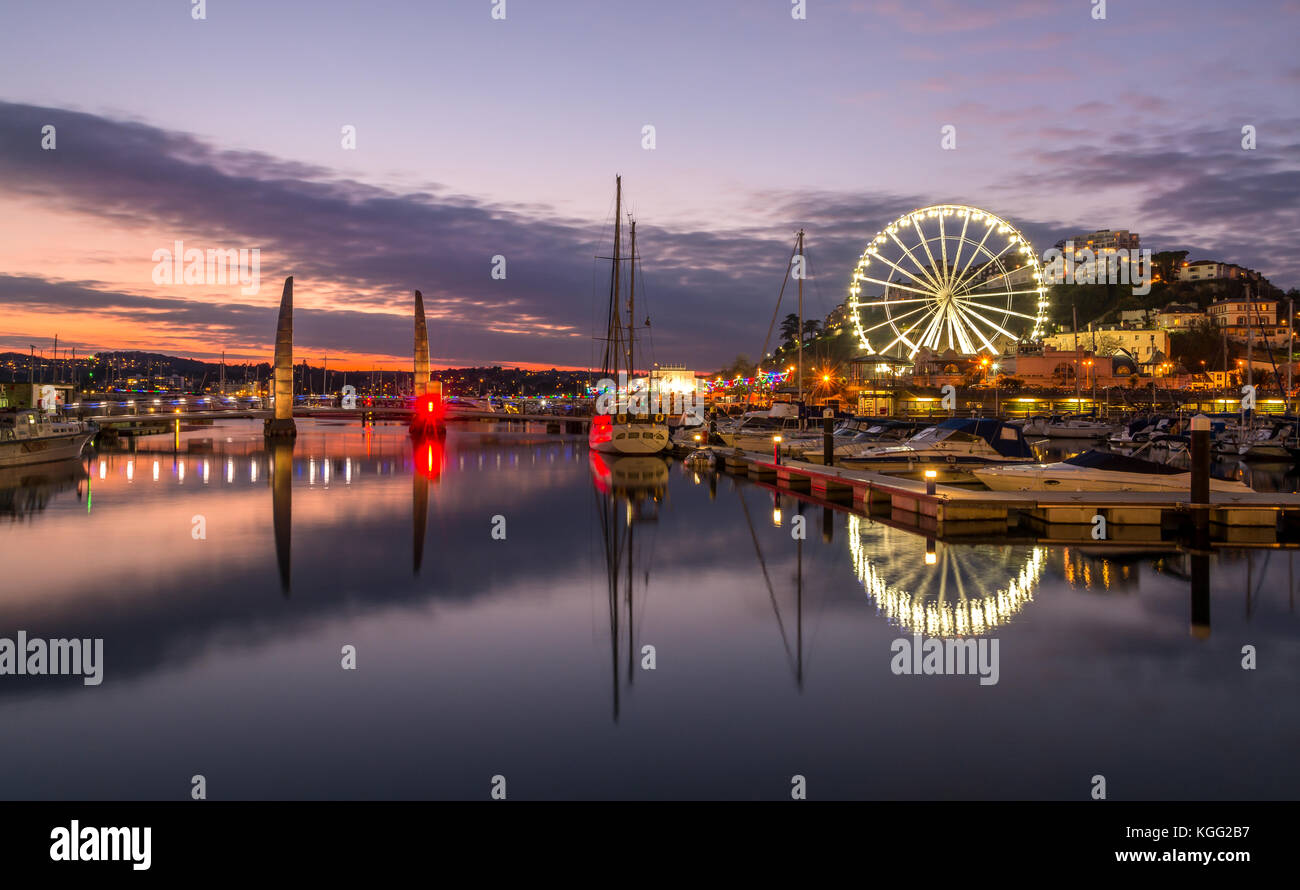 Torquay Harbour and wheel at twilight. Stock Photo