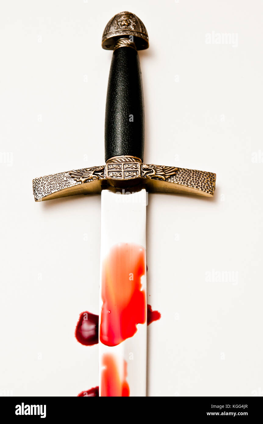 medieval sword handle and blade covered with blood - Stock Image