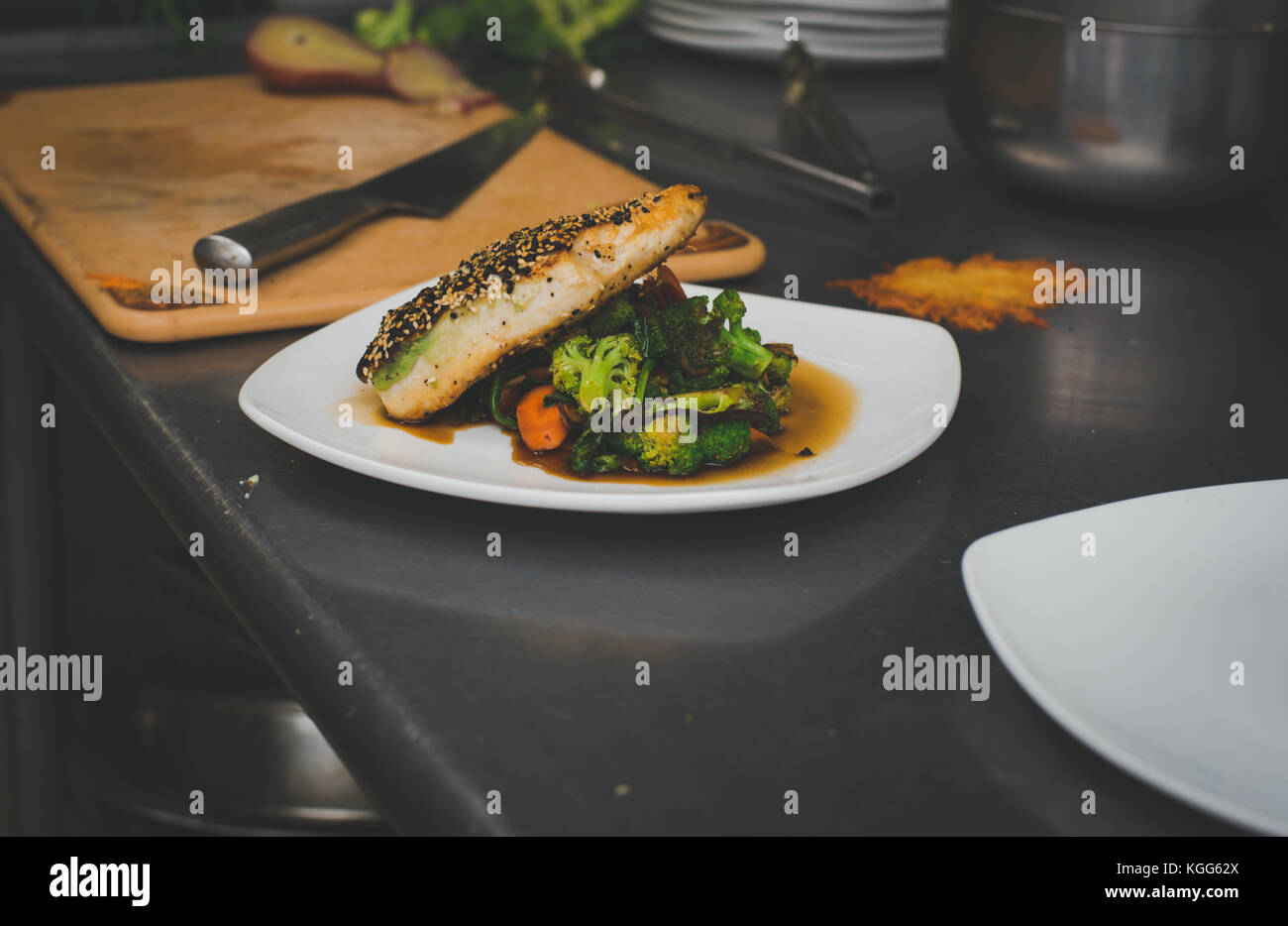Salmon and vegetables prepared at a restaurant - Stock Image