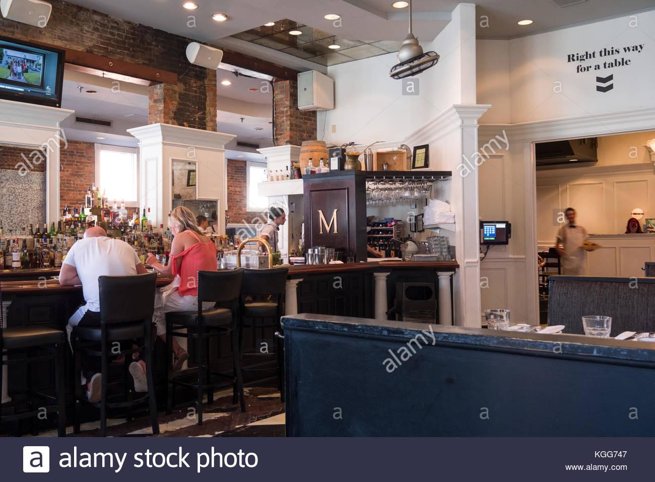 Man and woman sitting at bar inside Merchants Restaurant