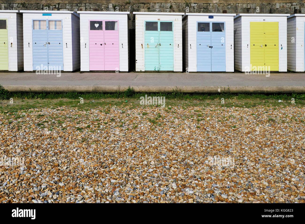 Row of beach huts at Lyme Regis in Dorset. - Stock Image