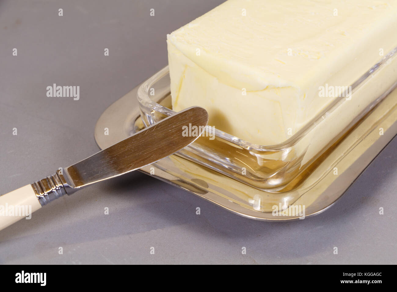 Knife and pack of butter in a butter dish Stock Photo