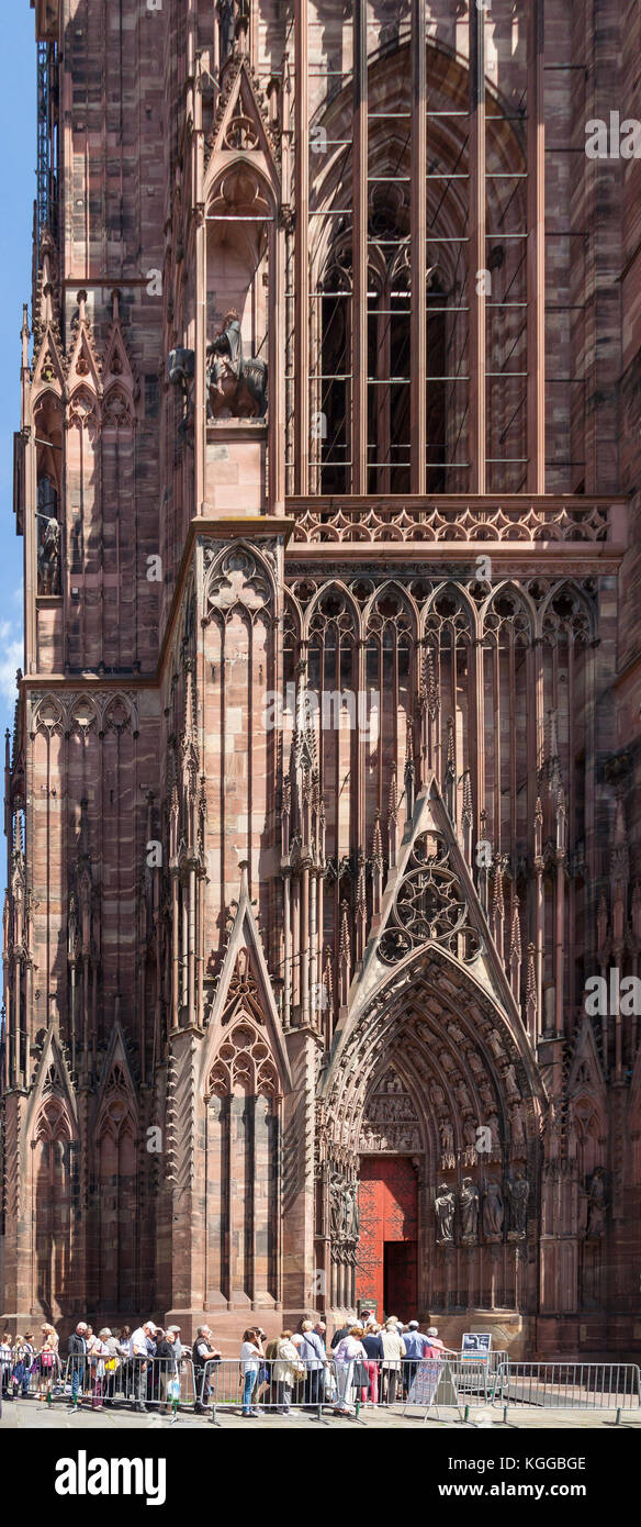 Tourists waiting to enter Strasbourg Cathedral, a High Gothic architectural masterpiece and landmark in Alsace, - Stock Image