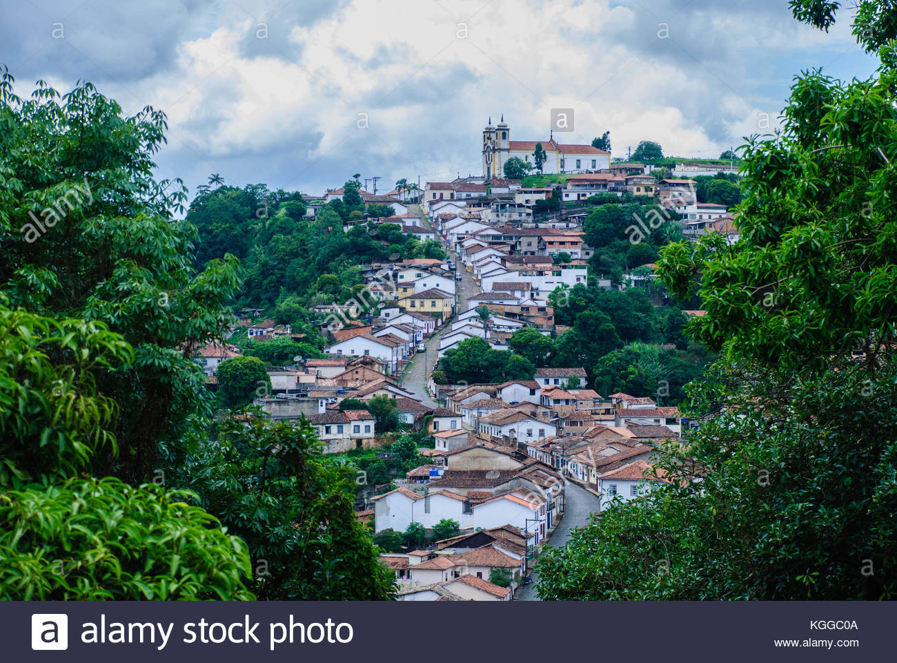 Amazing landscape in historic medieval city, on Brasil. On shot, appears a blue cloud sky, trees, mountains, vintage - Stock Image