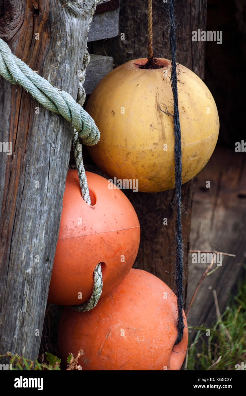 Weathered old floats on the quay - Stock Image