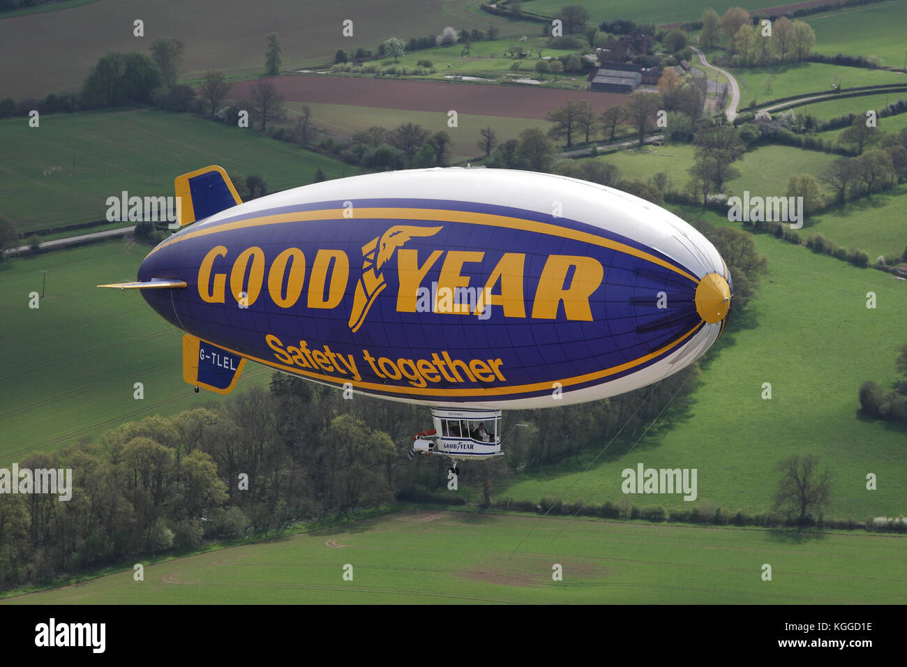 Air to air in flight Goodyear dirigible blimp / airship G-TLEL Spirit of Safety airborne flying over Shropshire - Stock Image