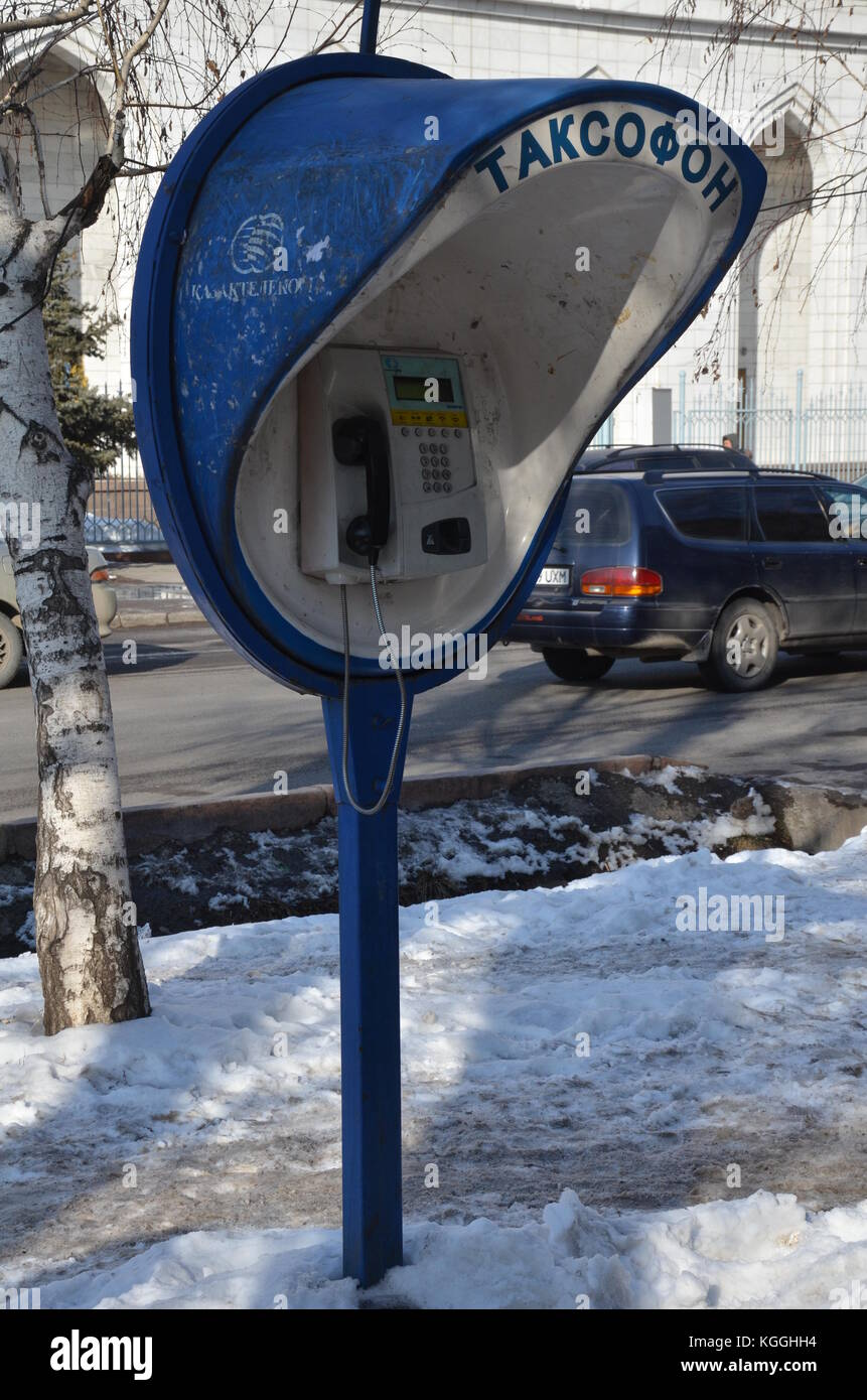 Takcofon, payphone in Almaty, Kazakhstan during snowy winter time. Still working, in use. - Stock Image
