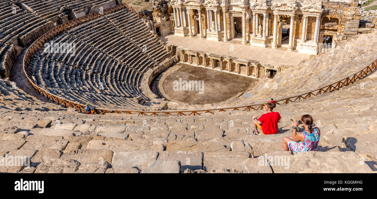People visit The ruins of Antique Theater in ancient Greek city Hierapolis, Pamukkale, Turkey.25 August,2017 - Stock Image