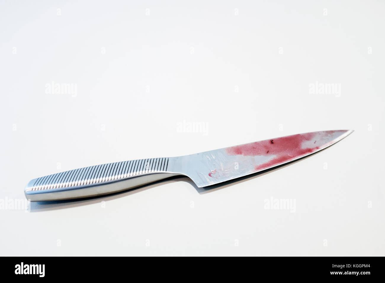 Bloody kitchen knife - Stock Image