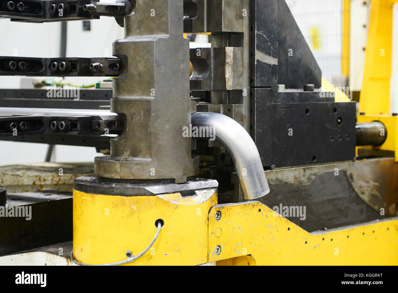 Robot bending pipe in modern factory - Stock Image
