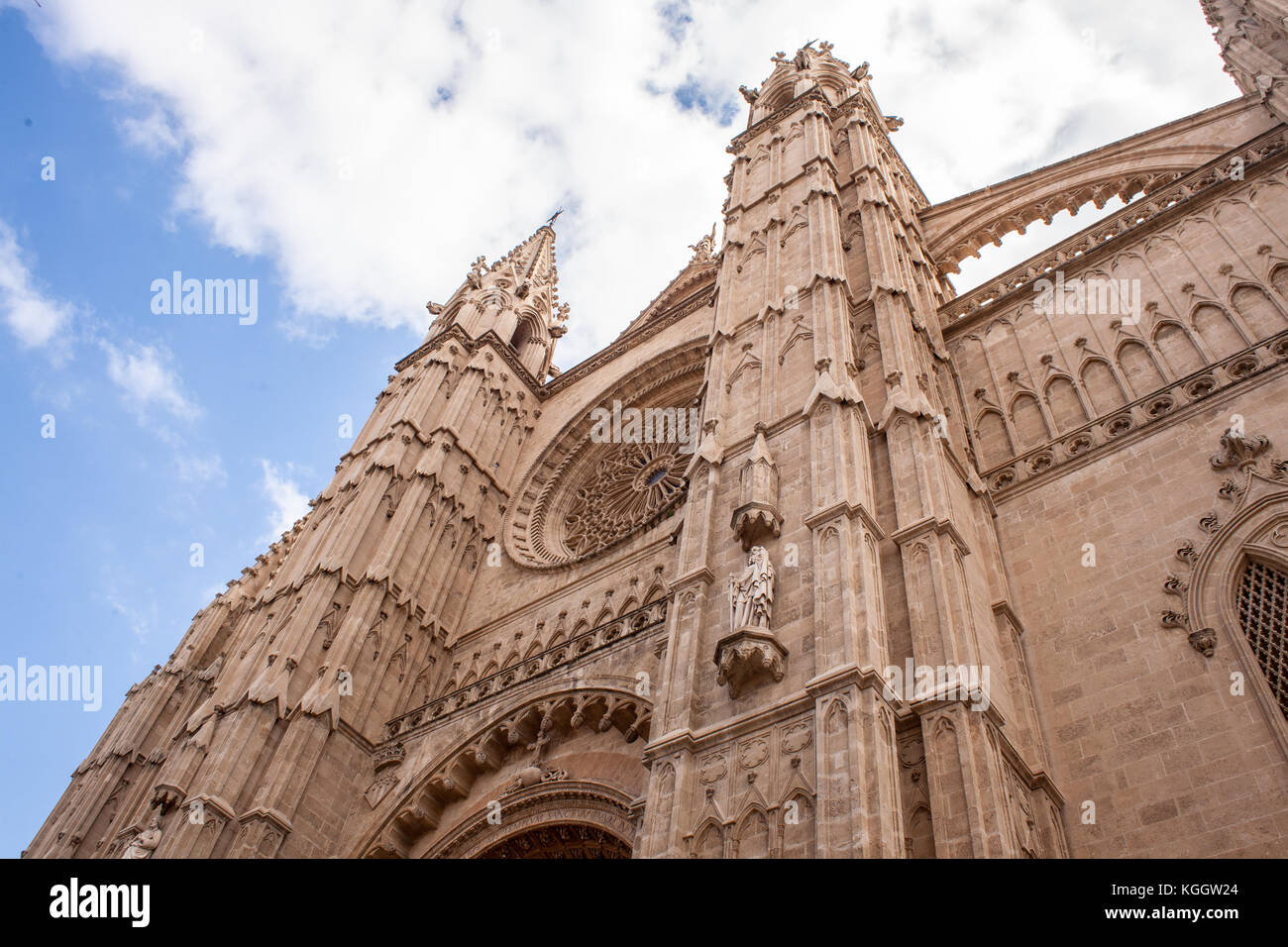 Cathedral Le Seu in Palma de Mallorca, a popular tourist destination, against a blue sky with clouds - Stock Image