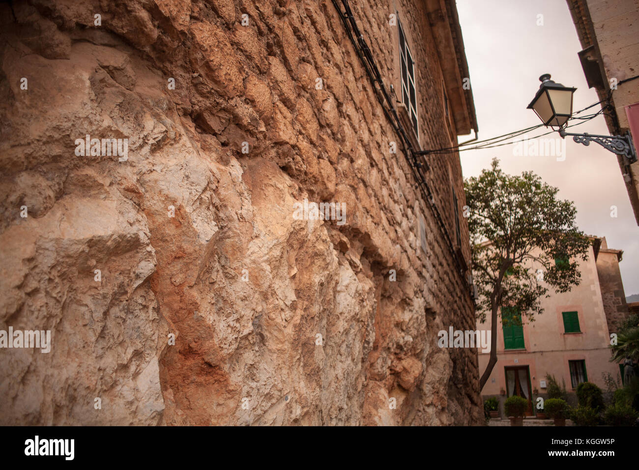 Crumbling stone on old home in Valldemossa, Mallorca - Stock Image