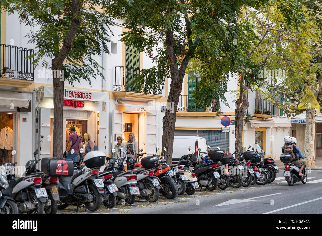 Scooters and shops, Ibiza Town, Balearic Islands,  Spain. - Stock Image