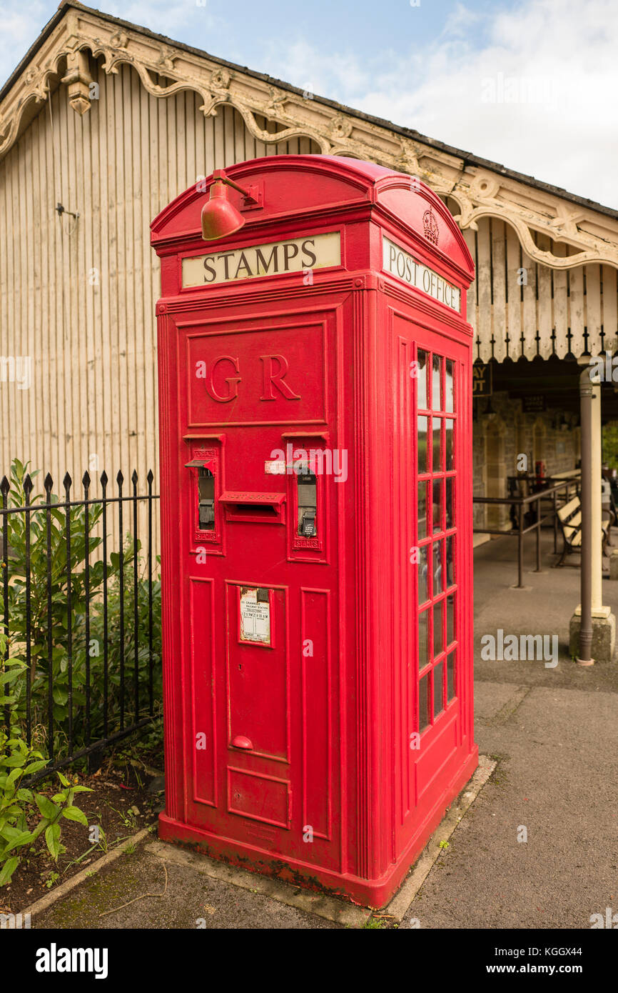 A very rare old K4 combined public telephone kiosk and vending machine for postage stamps and a serviced post box - Stock Image