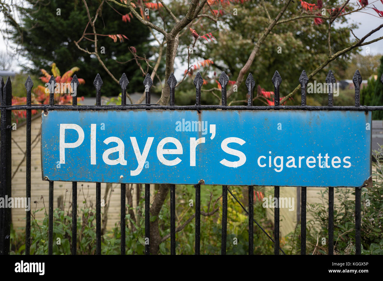 Old metallic advertisement for Player's cigarettes seen at a heritage steam railway station in Somerset UK - Stock Image