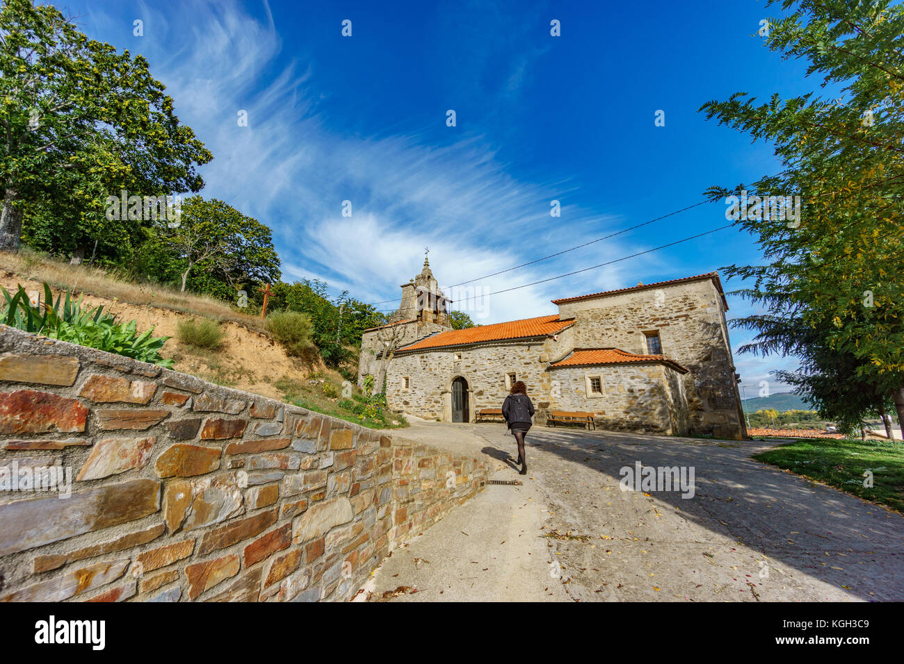 Believer walking towards Pobladura de Aliste church - Stock Image