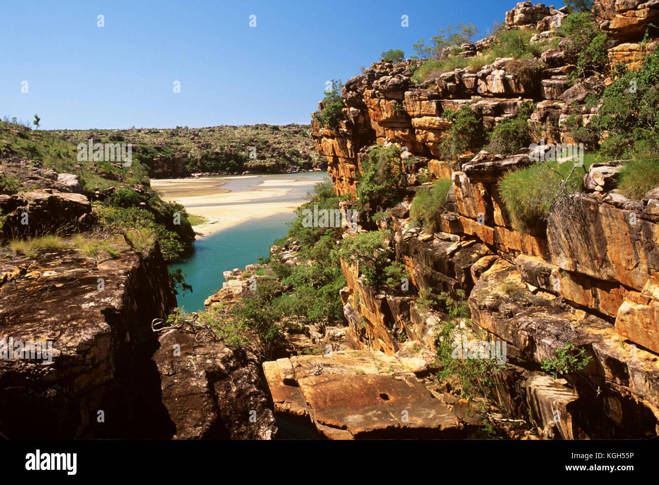 Sandstone escarpment and coast where mangroves border the tidal zone. Kimberley region, Western Australia, Australia Stock Photo