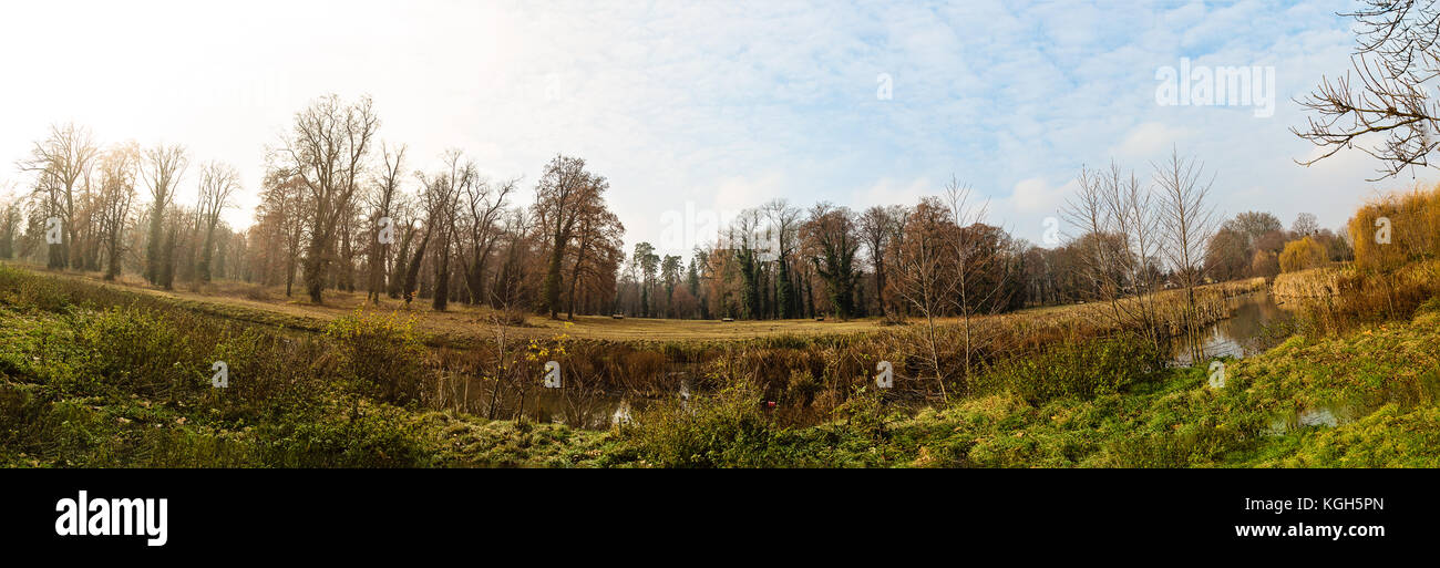 panorama of cultivated park in autumn. Orange,brown color tones. - Stock Image