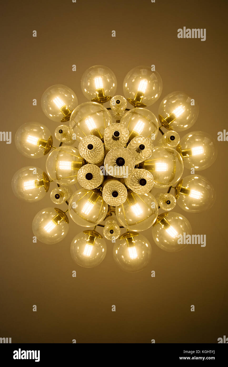Crystal Glass Chandelier View From Bottom Round Shape Bulb Covers Lit Energy Efficient Light Bulbs