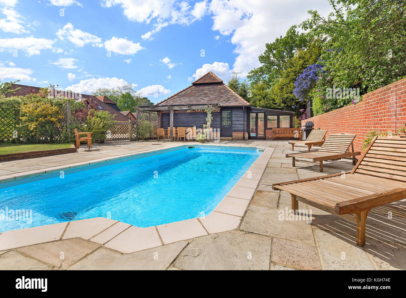 Outdoor Swimming Pool Area In Large Country Home Stock Photo Alamy