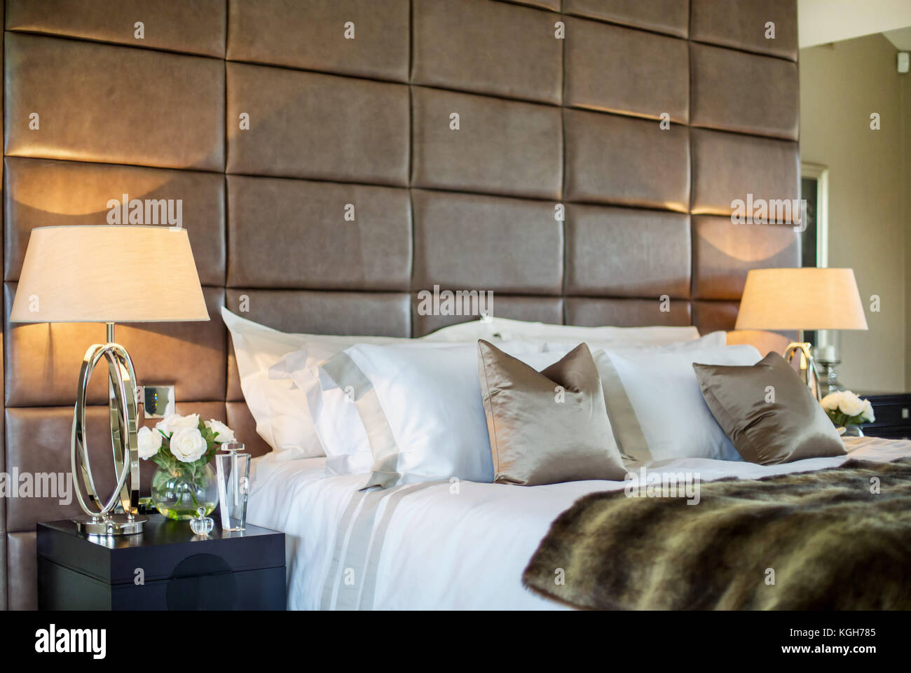 Tight shot of luxury bed in large house - Stock Image