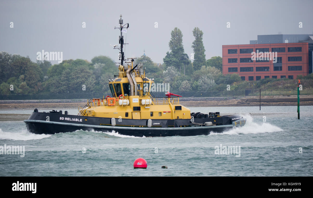 SD Reliable is a tractor tugs designed by Damen for assisting modern naval warships entering Portsmouth harbour - Stock Image