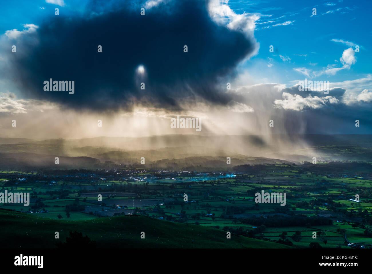 Dark Rain cloud over Ruthin North Wales. - Stock Image