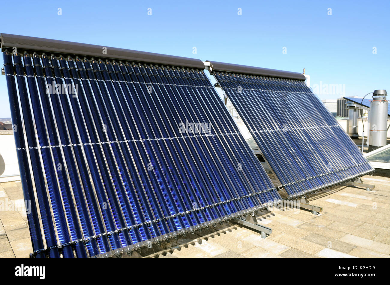 Evacuated tube solar collector panels on rooftop Stock Photo