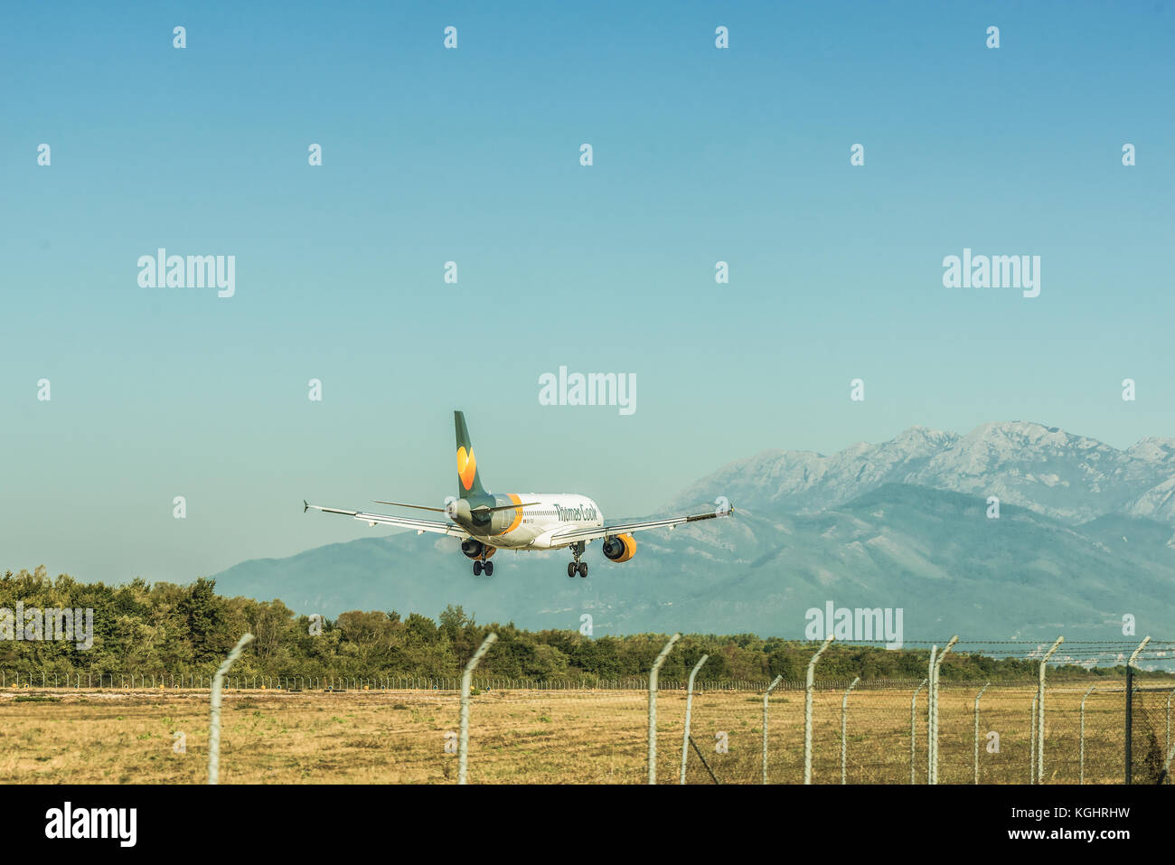 Montenegro, Tivat - August 24, 2017: Passenger plane lands at Tivat airport in Montenegro. - Stock Image